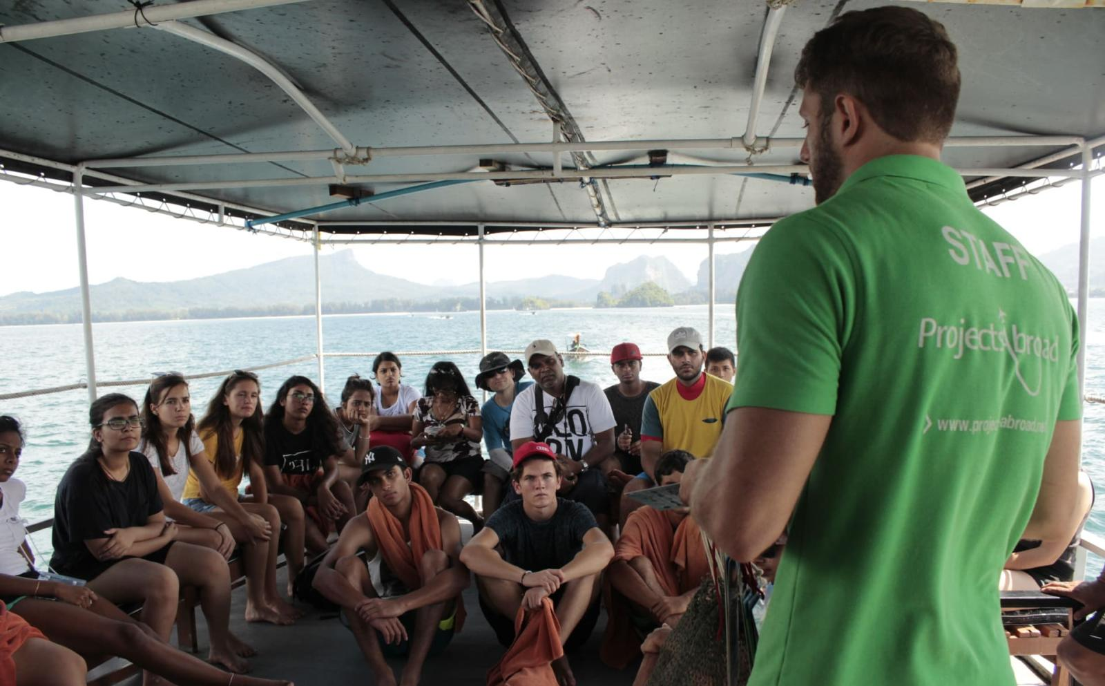 Project's Abroad staff giving travelling volunteers a diving brief on responsible diving